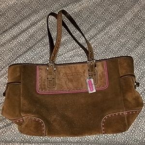 Leather Coach purse with pink lining